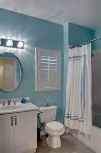 Love the color of the teal wall paint in this bathroom