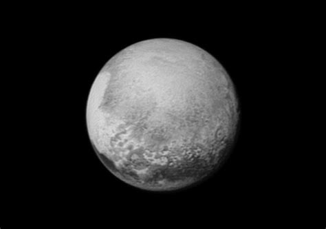 what of is pluto pluto s bright mysterious is rotating into view nasa