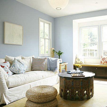 soft blue wall color scheme  modern white sofa  small