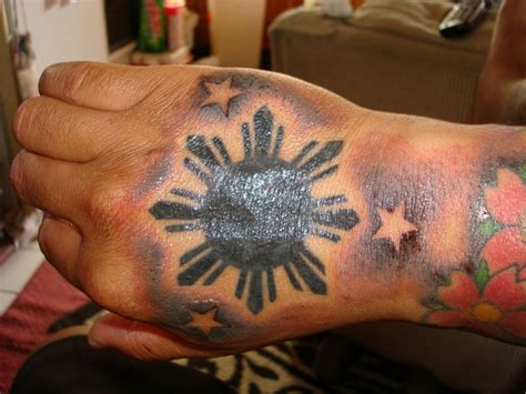 3 stars and a sun tattoo tribal sun on busbones