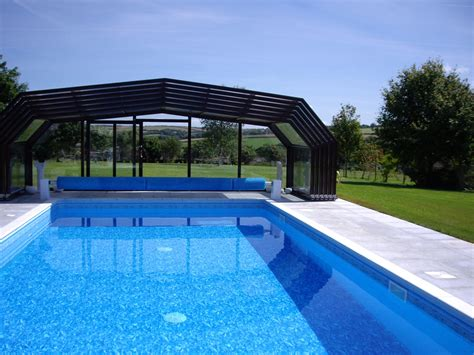 enclosed swimming pools summit leisure telescopic swimming pool enclosure to