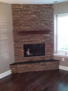 custom corner stone direct fireplace craftsman family