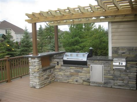 outdoor kitchen on a trex deck with arbor decking