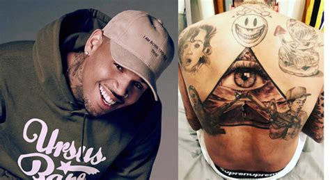 chris brown gets a huge tattoo at the chris brown gets a black pyramid but says he is