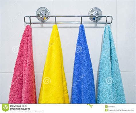 how to hang towels in bathroom colorful towels hanging in a bathroom stock photo image