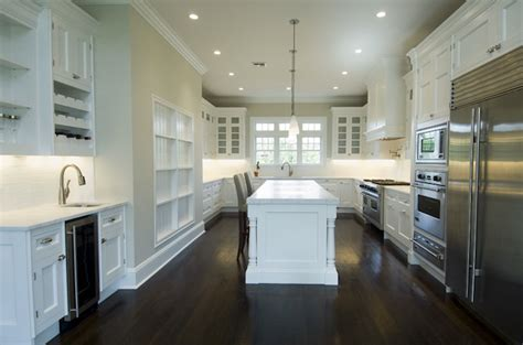 kitchens with white cabinets and dark floors white kitchen cabinets with dark wood floors