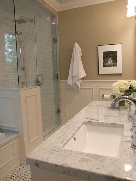 marble wainscoting carrara marble tub deck and basket weave floor shower and
