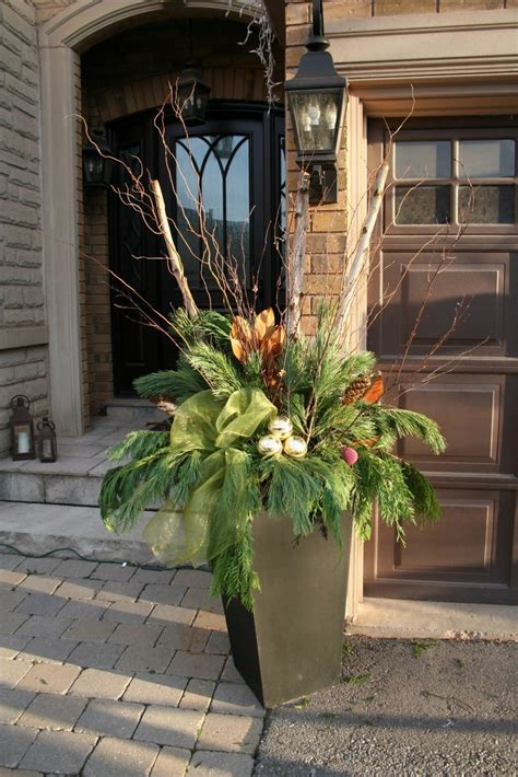 christmas decorating huge stone urns in front of entrance 624 best images about winter containers on window boxes arrangements and