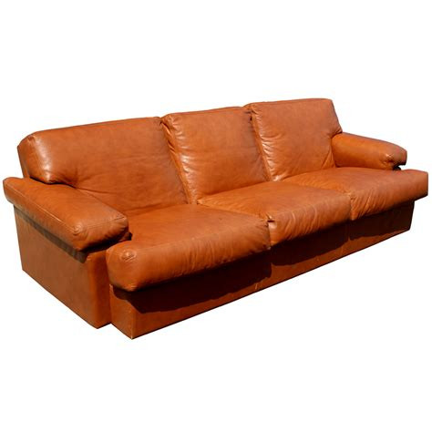 burnt orange leather sofa midcentury retro style modern architectural vintage