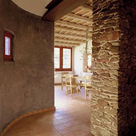wall of tile megans house pinterest love the adobe wall and the stacked stone rough vs