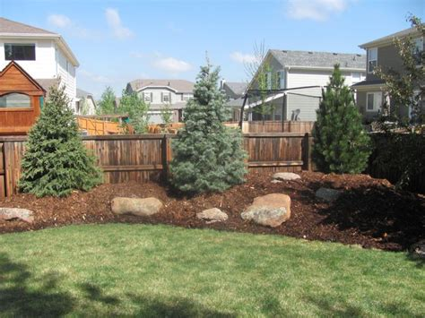 Landscape Ideas In Colorado Privacy Berm Along A Fence Adds Years To Plant
