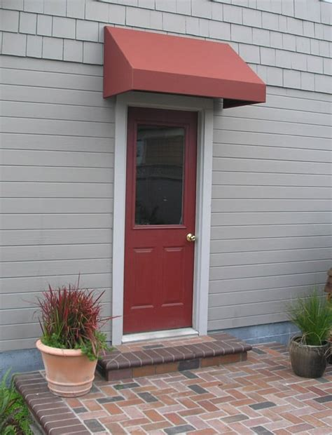 awning over garage door awnings can soften the facade of a dull building this