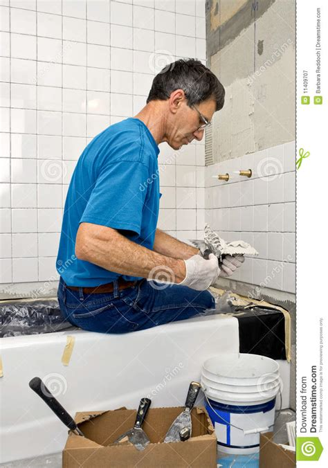 man bathroom man tiling a bathroom wall royalty free stock photography
