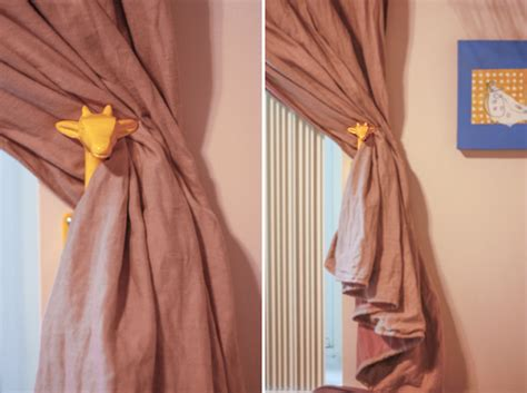 where to put holdbacks for curtains home away from home yellow giraffe curtain holdbacks