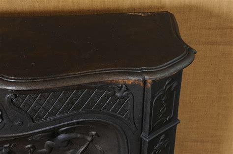 19th century cast iron pompadour fireplace