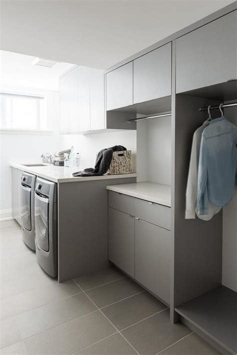 contemporary laundry room cabinets white modern laundry room with gray staggered floor tiles