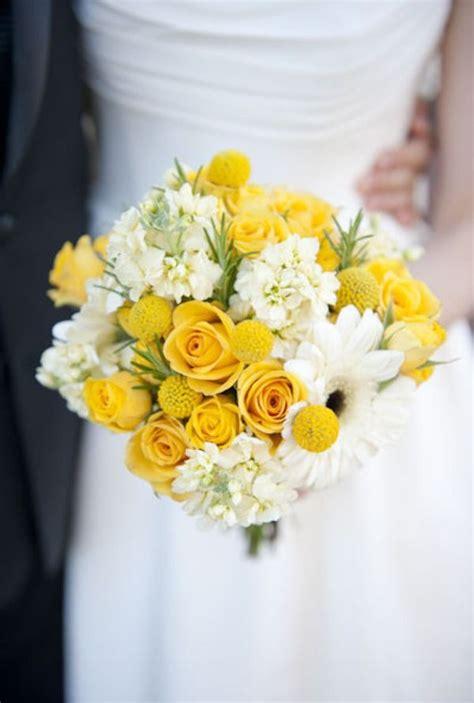 yellow white this one has yellow roses white stock gerber ranunculus small yellow