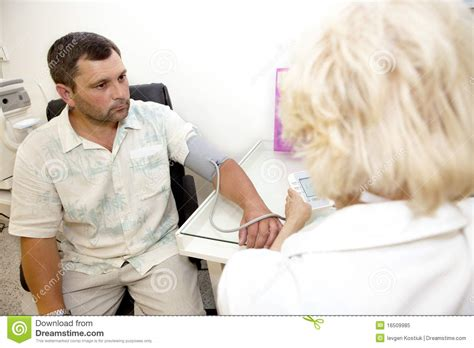 doctor examining woman doctor examining a patient royalty free stock photo