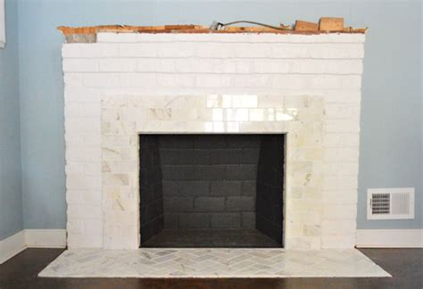 covering brick fireplace with ceramic tile fireplace makeover tiling the mantel with marble