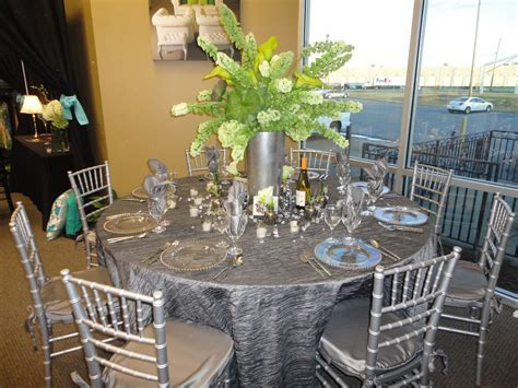 Silver Linens and Chiavari Chairs by Mahaffey Tent & Event