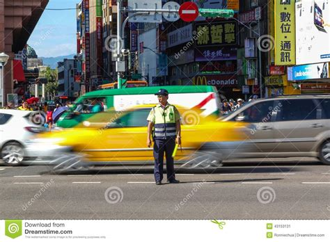 taiwan new year traffic traffic warden directs peak hour traffic in tapei