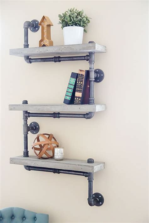 industrial chic concrete isn t just for sidewalks anymore industrial chic concrete and pipe shelves tutorial