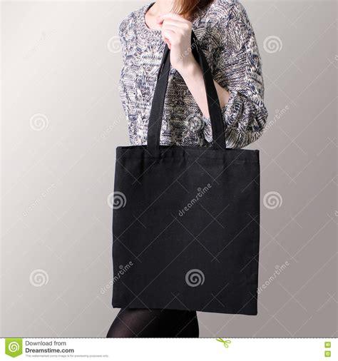 black tote bag mockup mock up girl is holding black cotton tote bag stock