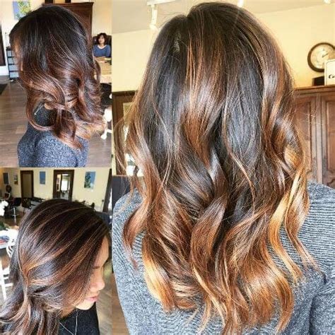 curly hair with lowlights caramel balayage on medium brown hair