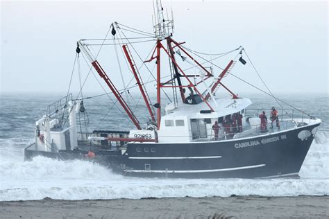 cost of fishing boat coast guard vessel capsizes on way to rescue fishing boat