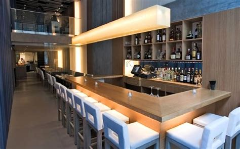 modern bar interior design of aldea restaurant new york