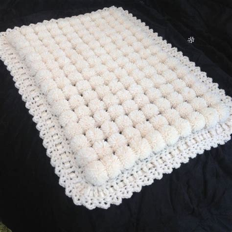 knitting pattern for pom pom baby blanket 17 best ideas about pram blankets on knitted