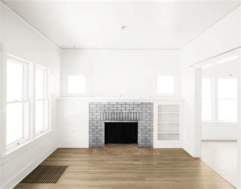 what to do with an empty room in your house empty room two rooms gray fireplace light br by