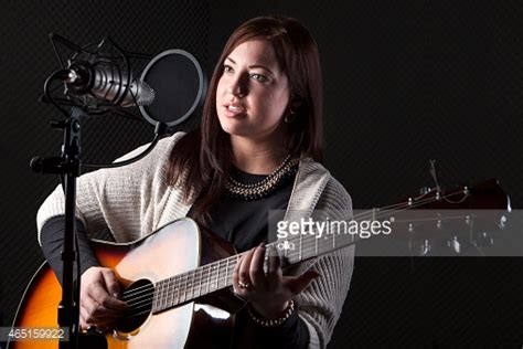 who is the singer guitar player that does the direct tv commercial young female guitar player singer sound recording studio