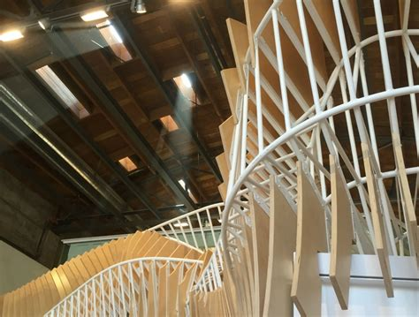 oyler wu collaborative create 3d food lab wallpaper ultra twisty wooden and steel staircase breathes as you