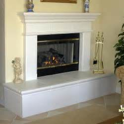 fireplace raised hearth updated with wood trim