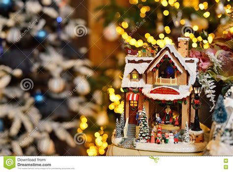 house christmas music adorable christmas music toy house with miniature santa presents decorated tree bokeh background