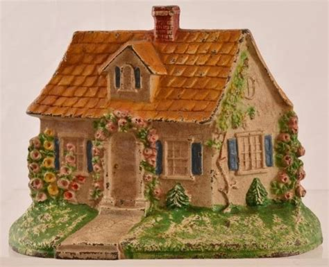 Cottage Cast by Antique Cottage Cast Iron Door Stop