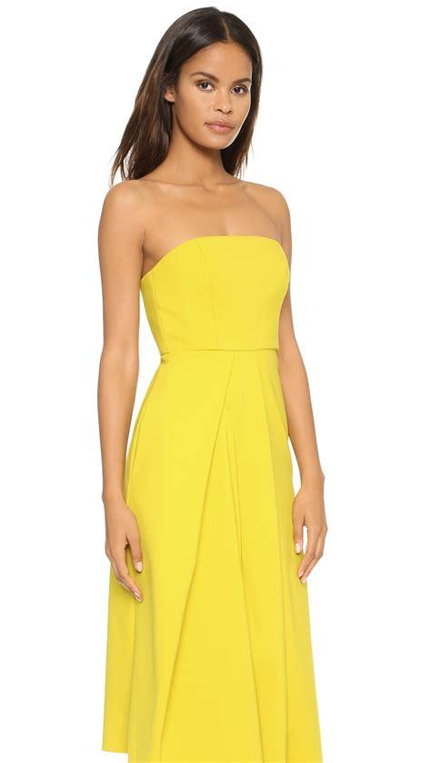 How To Copy Guccis Asymmetrical Yellow Dress For Less by Lyst Tibi Asymmetric Drape Strapless Dress Mustard