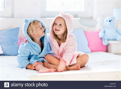 girls in bathroom with boys happy laughing kids boy and girl in soft bathrobe after