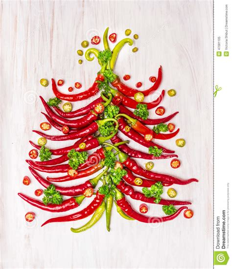 hot chili christmas tree on white wooden background stock