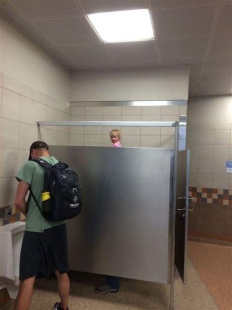 urinal peekaboo  girl peeks  bathroom stall