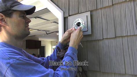 installing an outdoor light exterior light installation on vinyl siding block