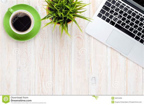 office desk table with laptop computer coffee cup and