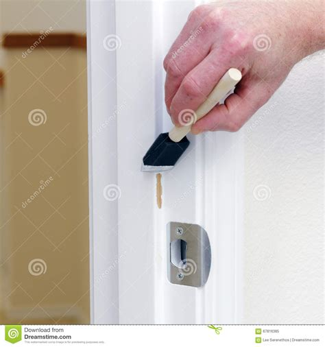 how to get a paint chip off the wall painting chipped off area on a door frame stock image