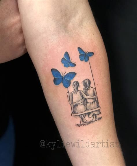 little girl tattoo two sitting on swing with blue