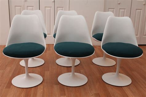 mixing modern chairs with antique table tulip chairs go eero saarinen knoll tulip chairs vintage mid century