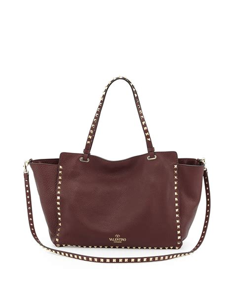 The Bag For The Who Is Doing The Gardener by Lyst Valentino Rockstud Grained Tote Bag In Purple