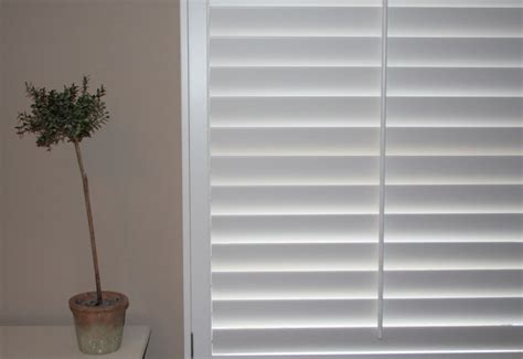 interior painted white shutters for indoor windows