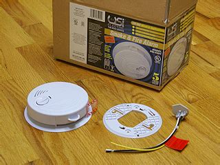 smoke detector wired into house installing smoke detectors ac powered line voltage hard wired smoke alarms for