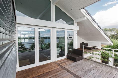 landhaus modern concentus fachwerkhaus glas verglasung holz fachwerk